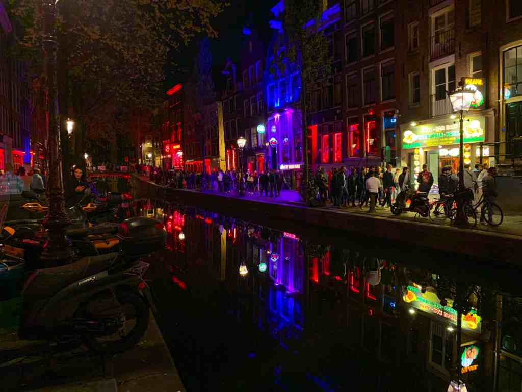The Red Light District at night in Amsterdam. The complexities of sex work and ethical travel.