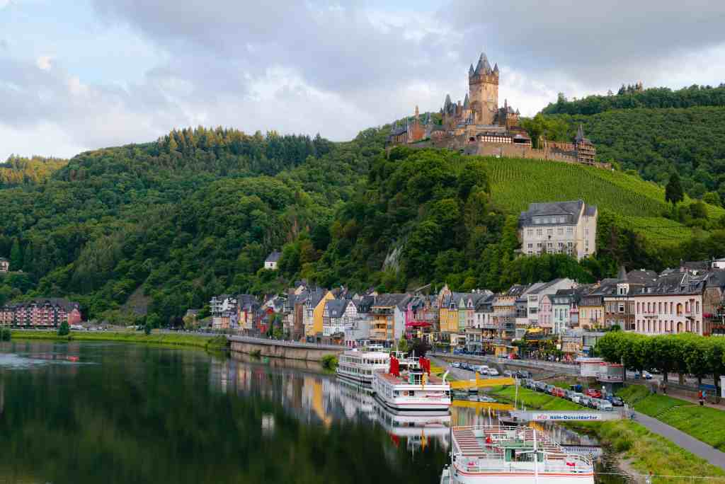 Rhine Valley with castle, river and village in Germany.