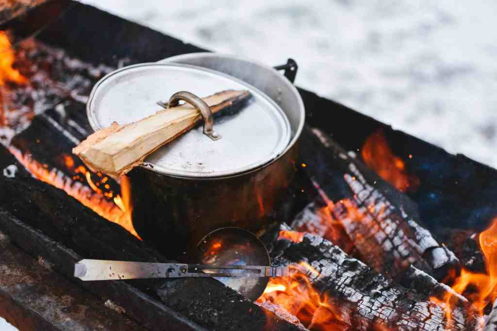 Food and drink while camping. A pot on the fire.