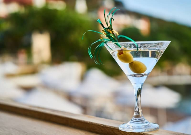 Martini with olive on a ledge