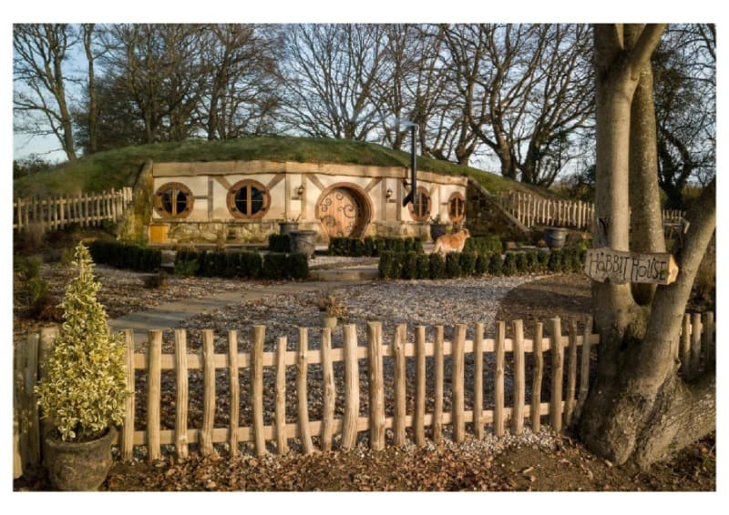 Front view of Hobbit House and its little garden in Rother Valley.