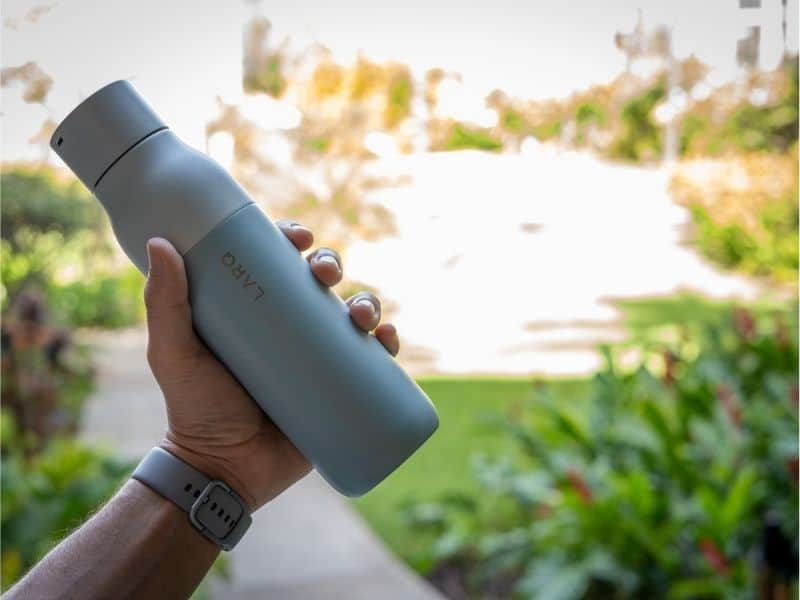Lifestyle image of LARQ water filter bottle. Someone holding it.