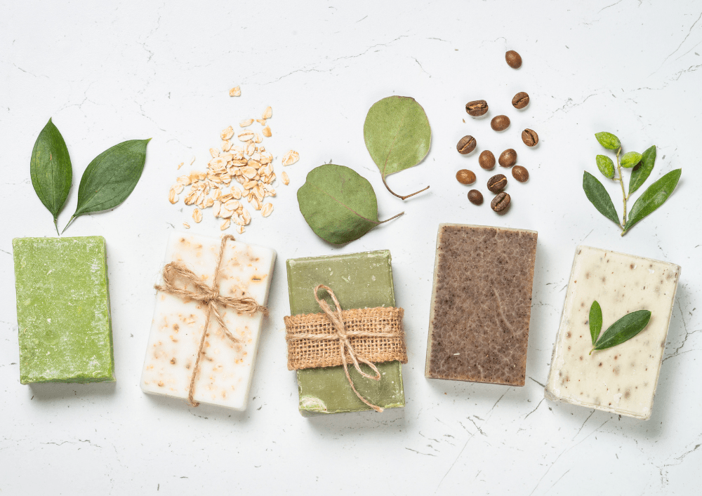 A selection of natural solid toiletries for travel with natural ingredients each bar is derived from.