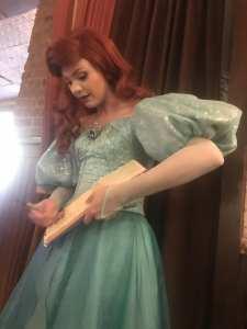 Ariel signing autograph book