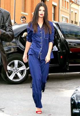 """That moment when you could honestly say """"I woke up like this"""". Selena isn't afraid to take fashion risks, and that's another key factor in her out of this world street style. She plays with fashion! This pajama-esque ensemble is one of my absolute favorites on her, because she looks so stylish in an undone, natural way. The satin pjs paired with bright red heels create a very posh look that seems almost as if Ms.Gomez rolled out of bed looking this glam. What's that? She didn't? I don't believe it..."""