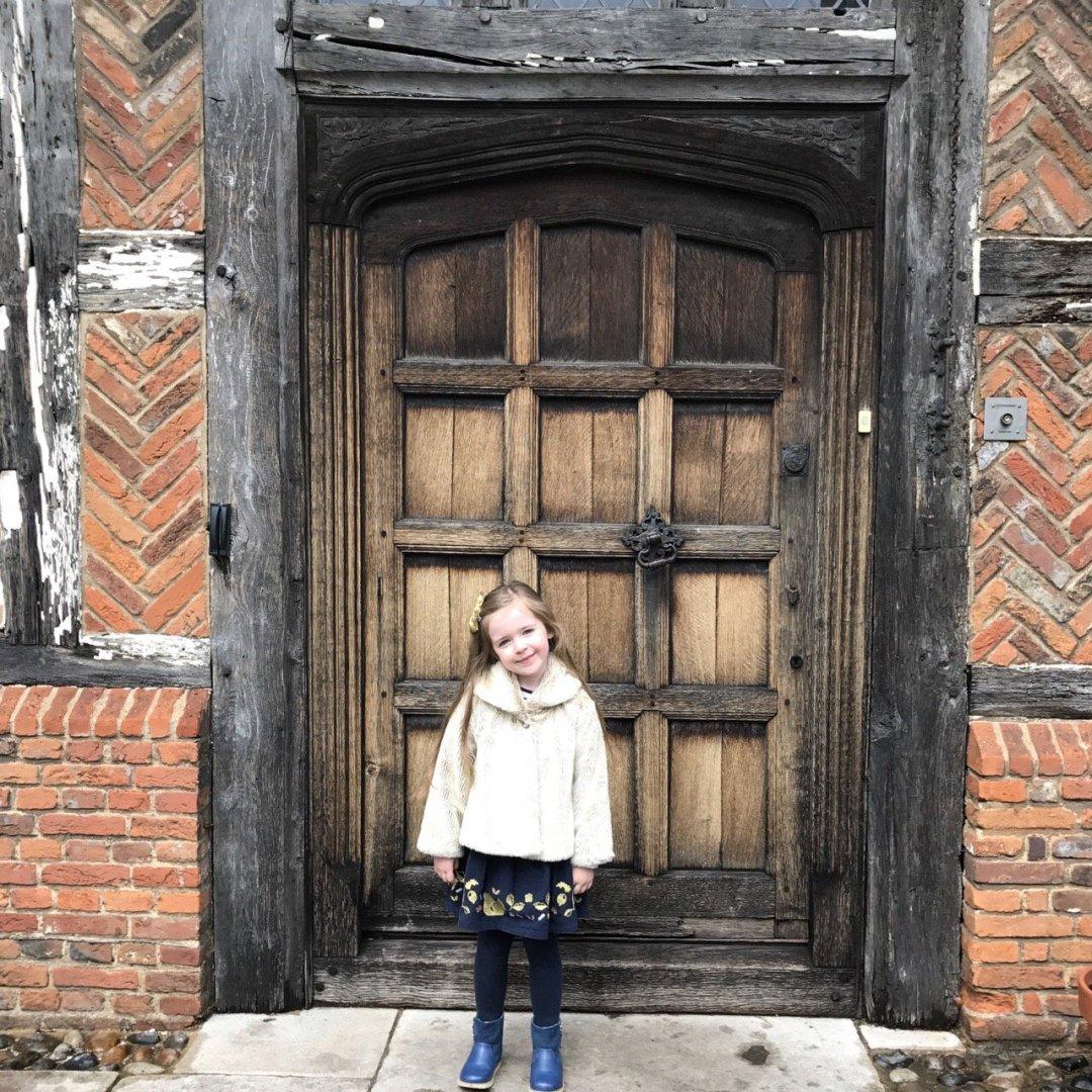 Afternoon Teas in Essex Eden standing in front of wooden door at Temperleys