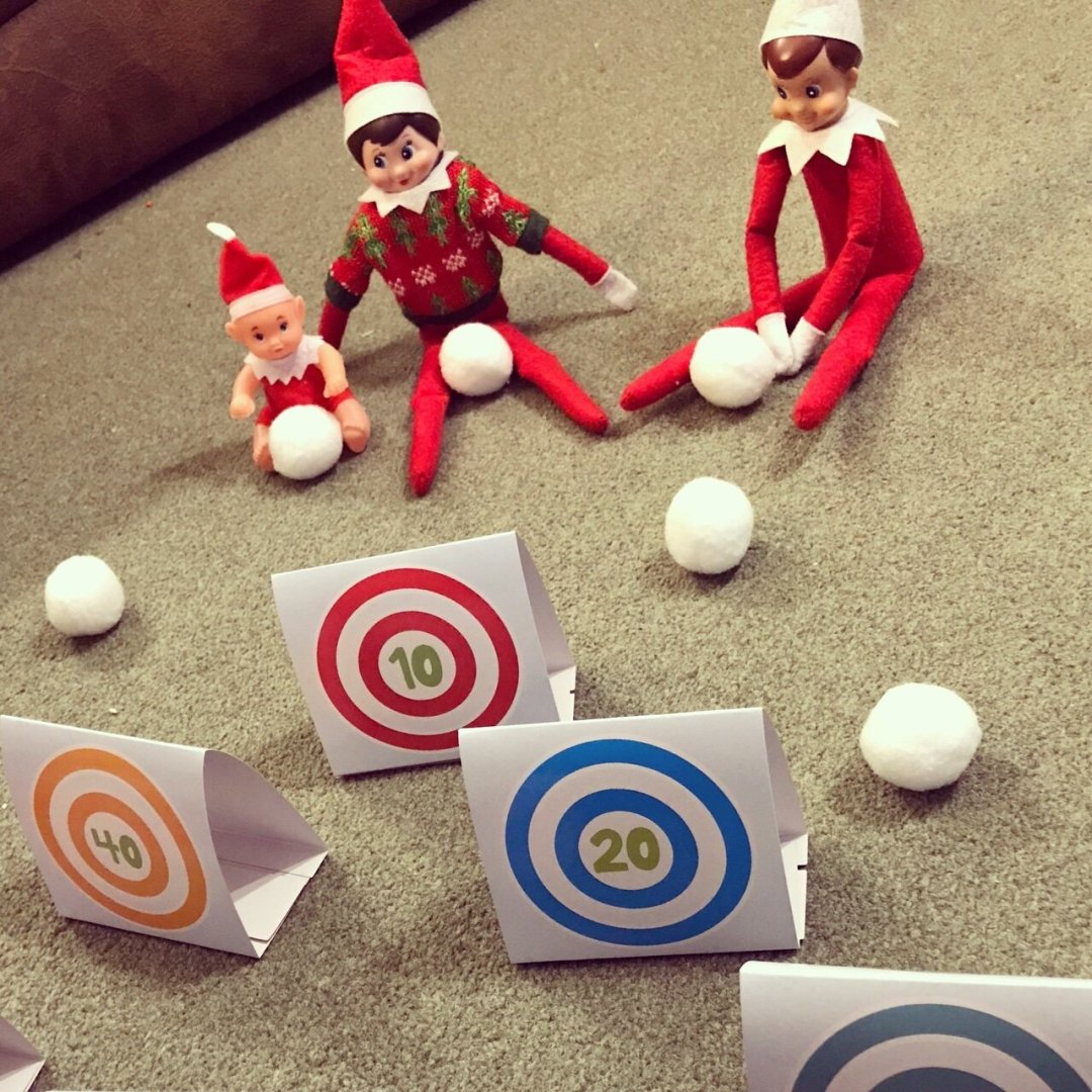 Elves playing snowball target practice