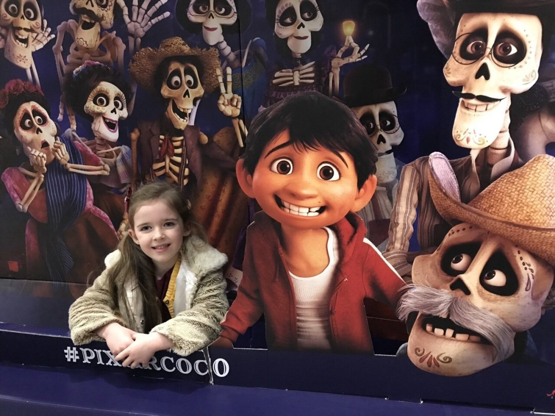 Eden posing with the Coco board at the cinema