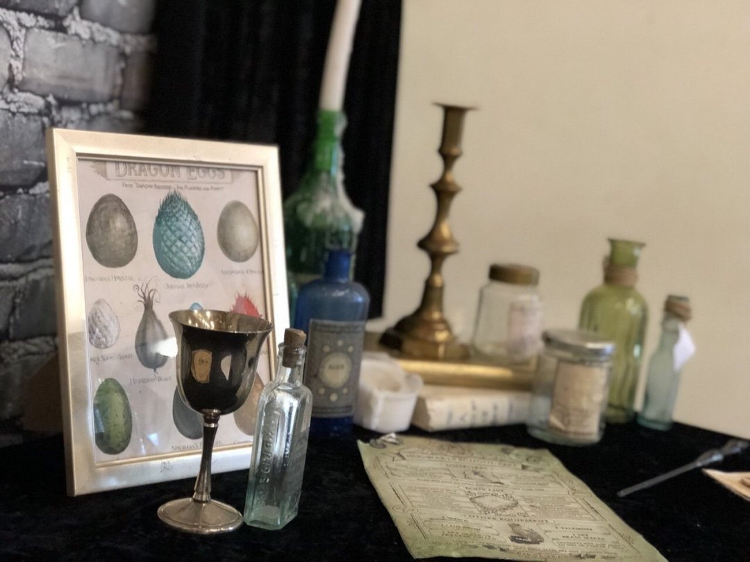 Magic themed table with bottles and goblets