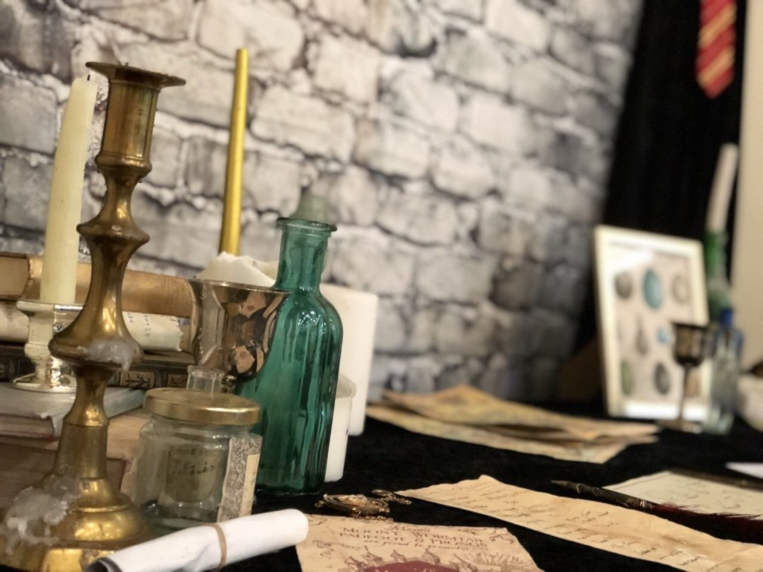 a magical themed afternoon tea Harry Potter themed table with spells, candlesticks