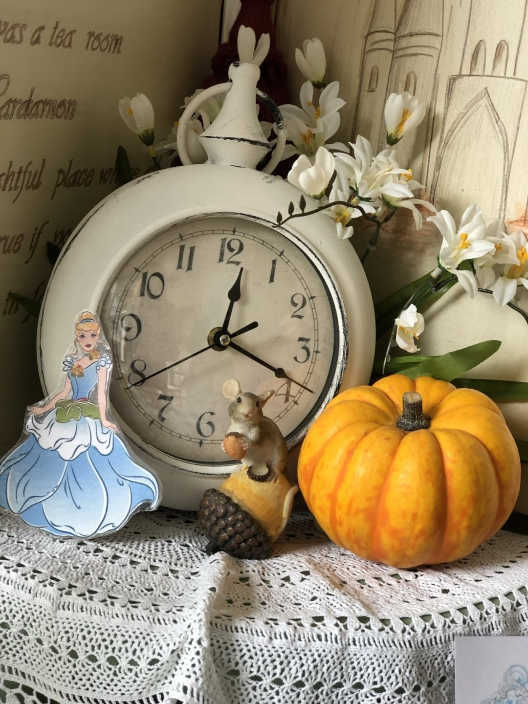 Cinderella Clock, pumpkin, and mouse, table setting from the Cinderella Afternoon Tea.