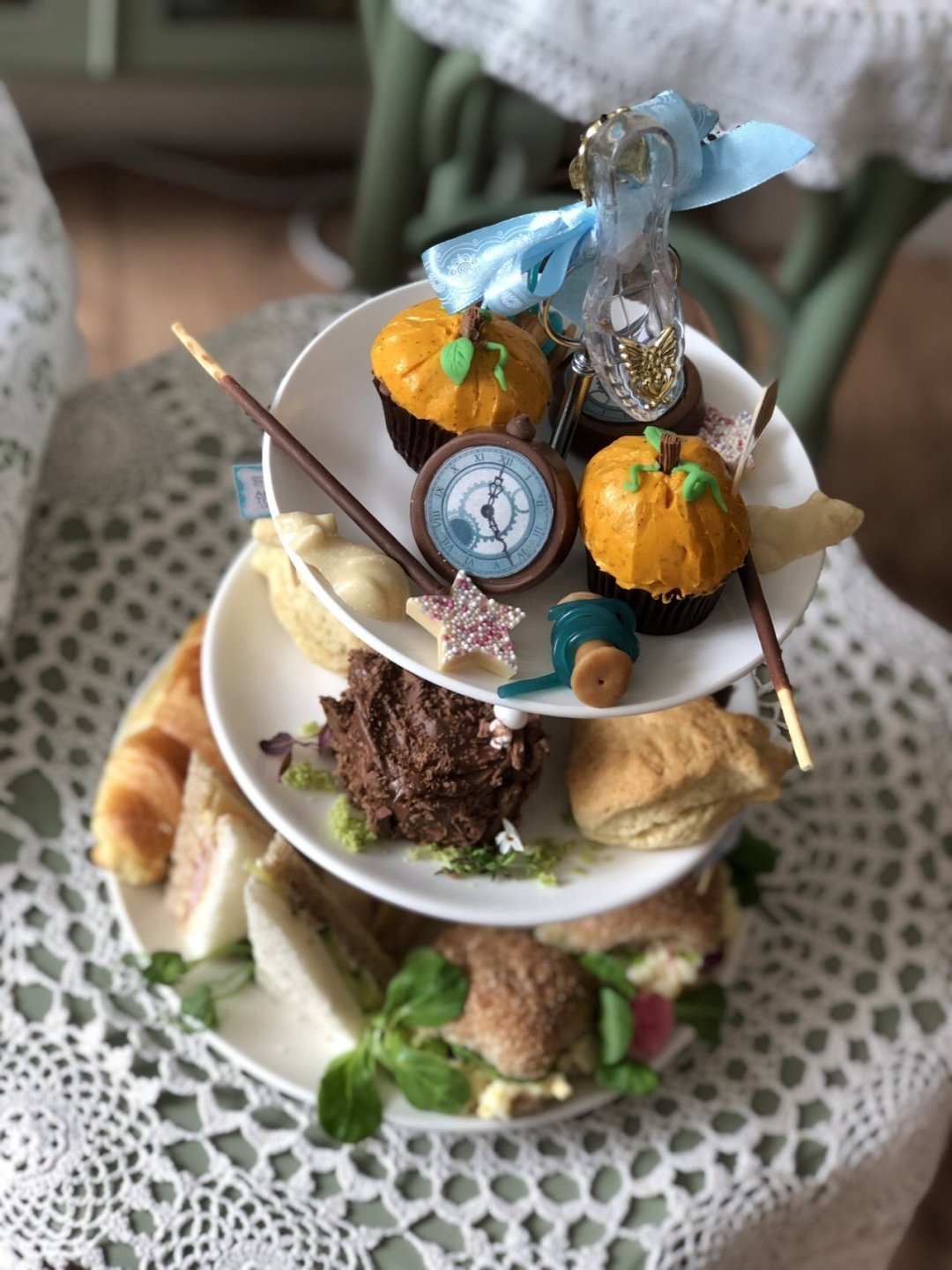 Top view of cake stand Cinderella Afternoon Tea. Glass slipper, pumpkin muffins