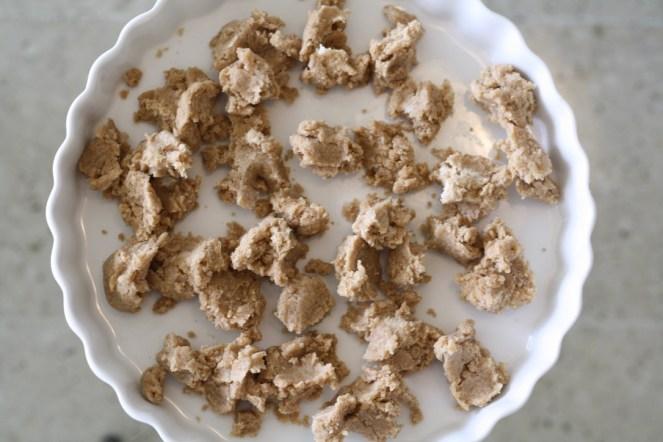 crumbles of tart dough in tart pan
