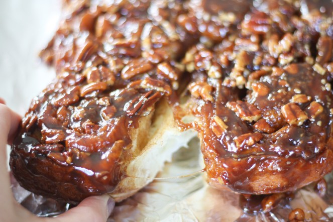 Pulling one sticky bun away from the rest