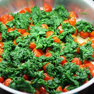 Sauté pan with tomatoes, shallots and spinach