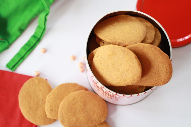 Can filled with butterscotch cookies, with more cookies on the side and red and green linens surrounding