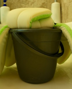I then drape it over the bucket I use to hold the water I bathe my daughter with.