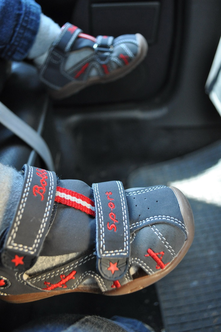 Little boys shoes in the car today