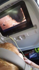 headphones and socks-toddler flight-plane trip with kids