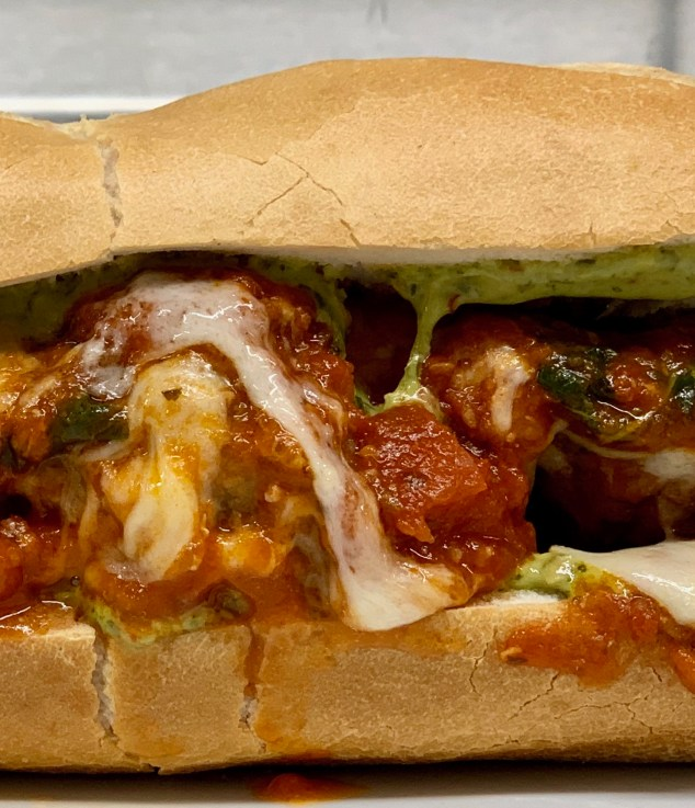 Little Pub Mmmeatball  Sandwich-  house made meatballs and marinara topped with melting provolone and served a fresh baked grinder roll with some really nice basil pesto and a side of fries 12