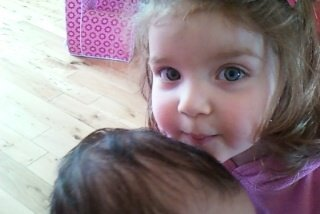 Hailey kissing her new little brother.x