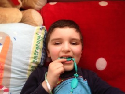 Conor chilled out with his MikaB Teething Jewellery.