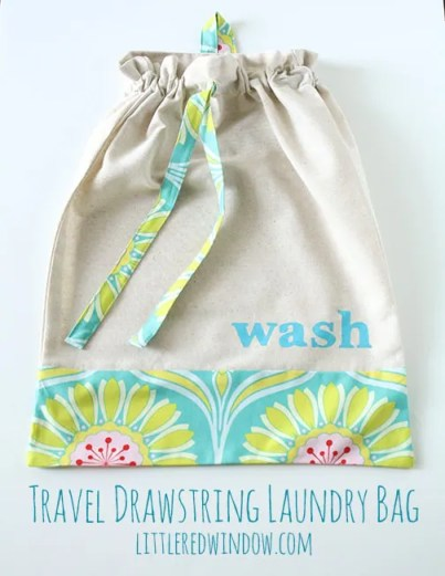 Travel Drawstring Laundry Bag Tutorial  |  littleredwindow.com | Make an pretty and useful travel laundry bag with cute stenciled detail with this great tutorial!