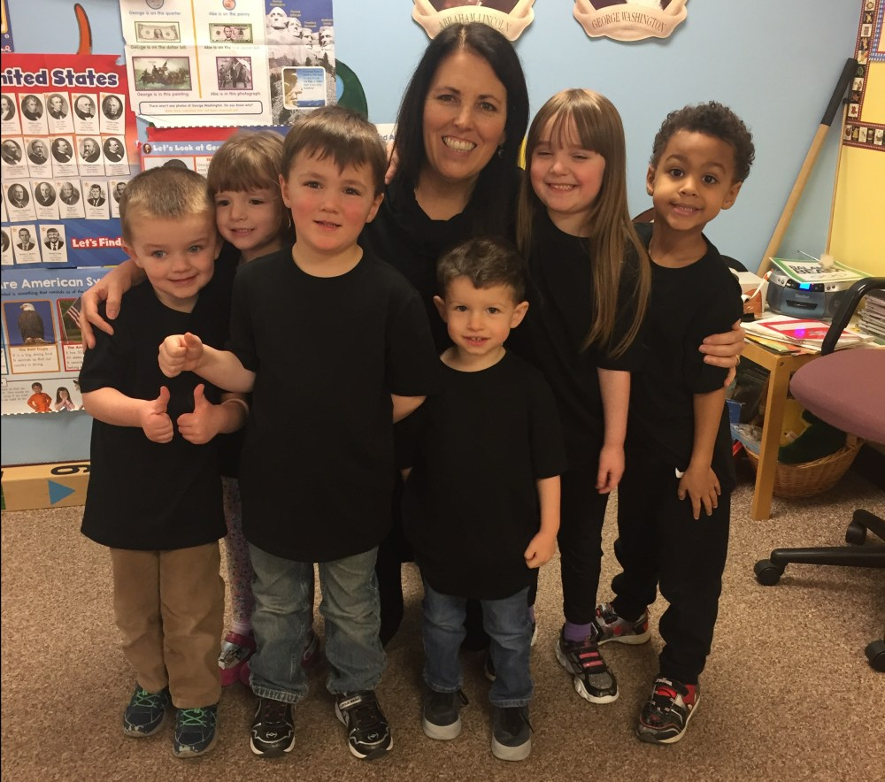 teacher with group of preschool ages students