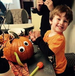 Max decorating his pumpkin