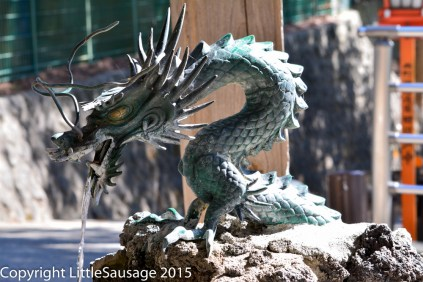 This dragon provides water for washing before visiting the shrine.