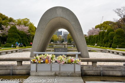 In the middle of the arch is a casket containing the names of all of the atom bomb victims.