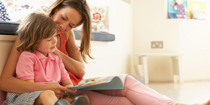 Mother Sitting With worried Son Reading Story