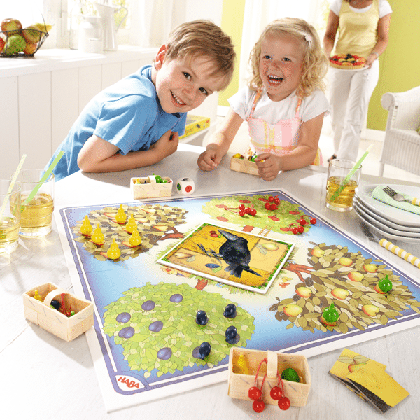 haba orchard board game being played by two children