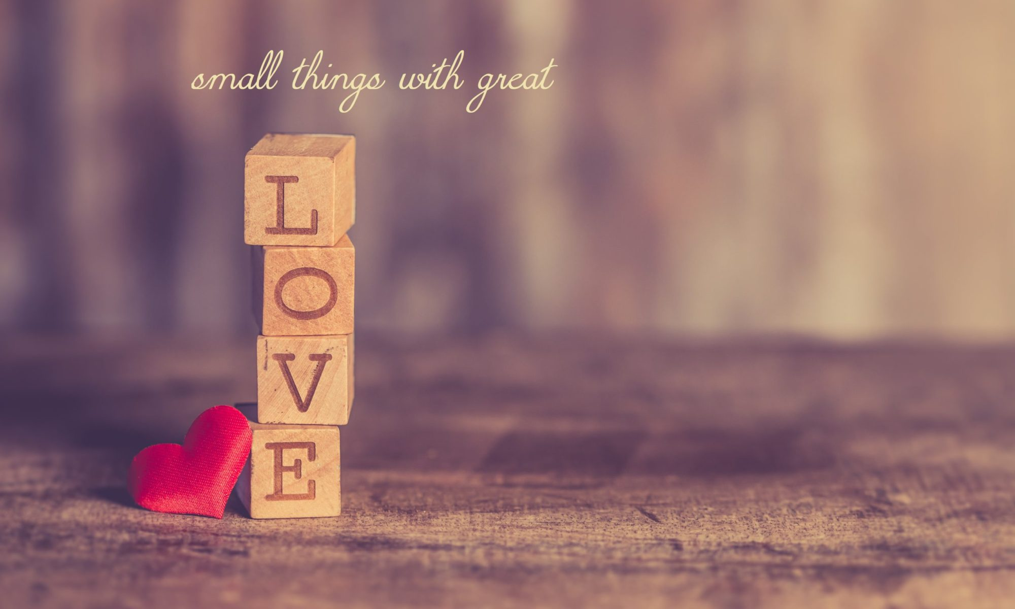 Words-small-tings-with-great-love-and-stack-of-love-wooden-blocks