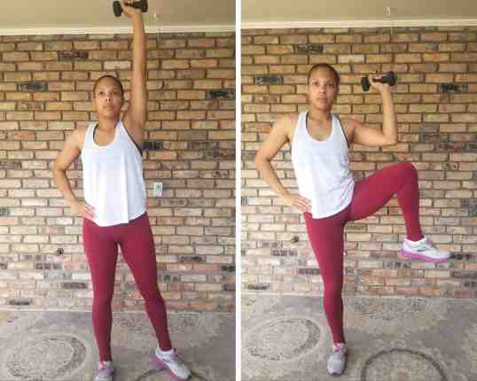 Standing Oblique Crunch - Need Some EMOM Workout Ideas? Try this EMOM Dumbbell Routine