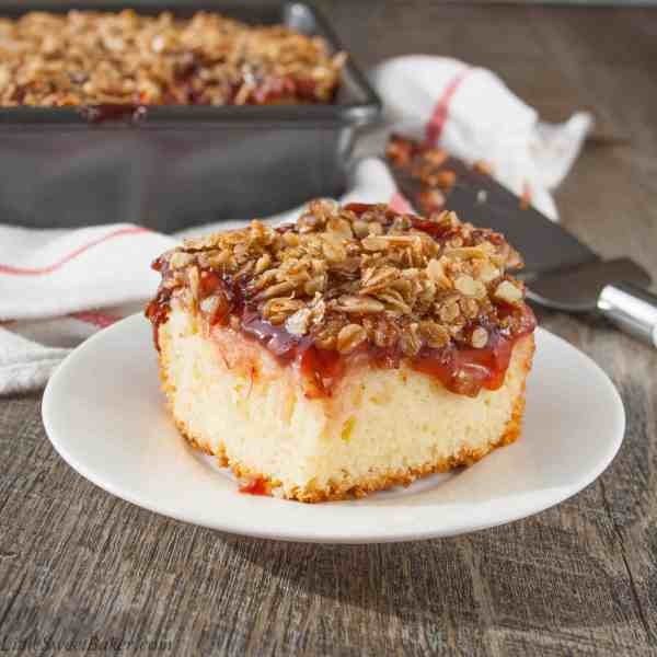 FRUIT TOPPED STREUSEL COFFEE CAKE. A delicious buttery coffee cake topped with sweet fruit pie filling and a crunchy cinnamon brown sugar almond & oat streusel.