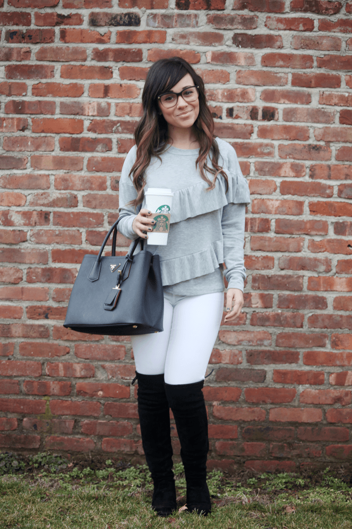 See how fashion, lifestyle, and beauty blogger Little Tree Vintage styles this on-trend ruffle top, over the knee boots, and white denim for chillier months.
