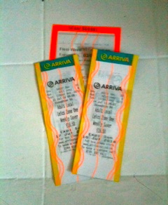 Neon laminated bus tickets.