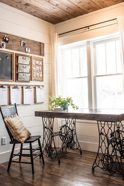 Farmhouse style home office with industrial desk and custom command center