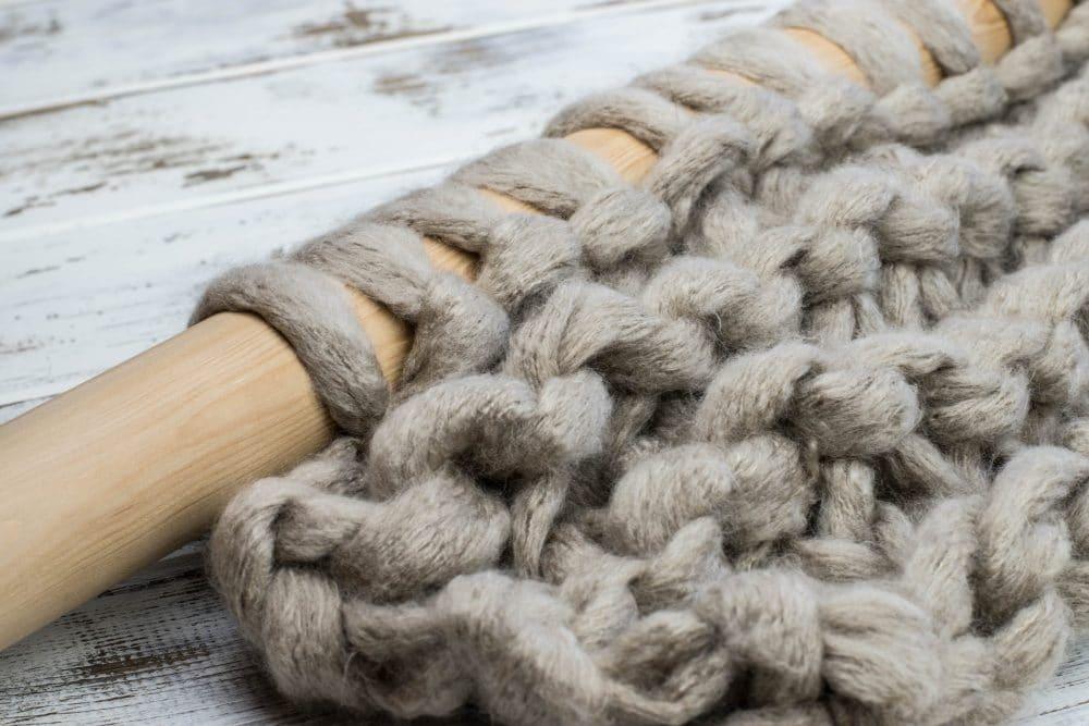 Close up of single jumbo yarn knitted on 55mm knitting needles.
