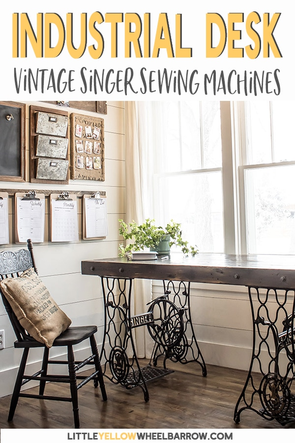 A rustic industrial desk made from two vintage sewing machine treadle bases.  An easy DIY if you can find matching bases! Perfect for a farmhouse style home office.