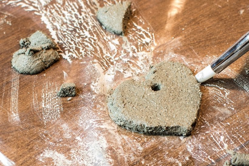 Moulding small heart shapes with concrete clay