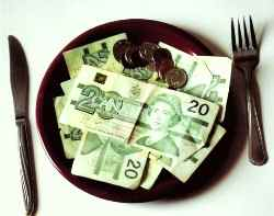 plate with dinner plate with money and coins on it