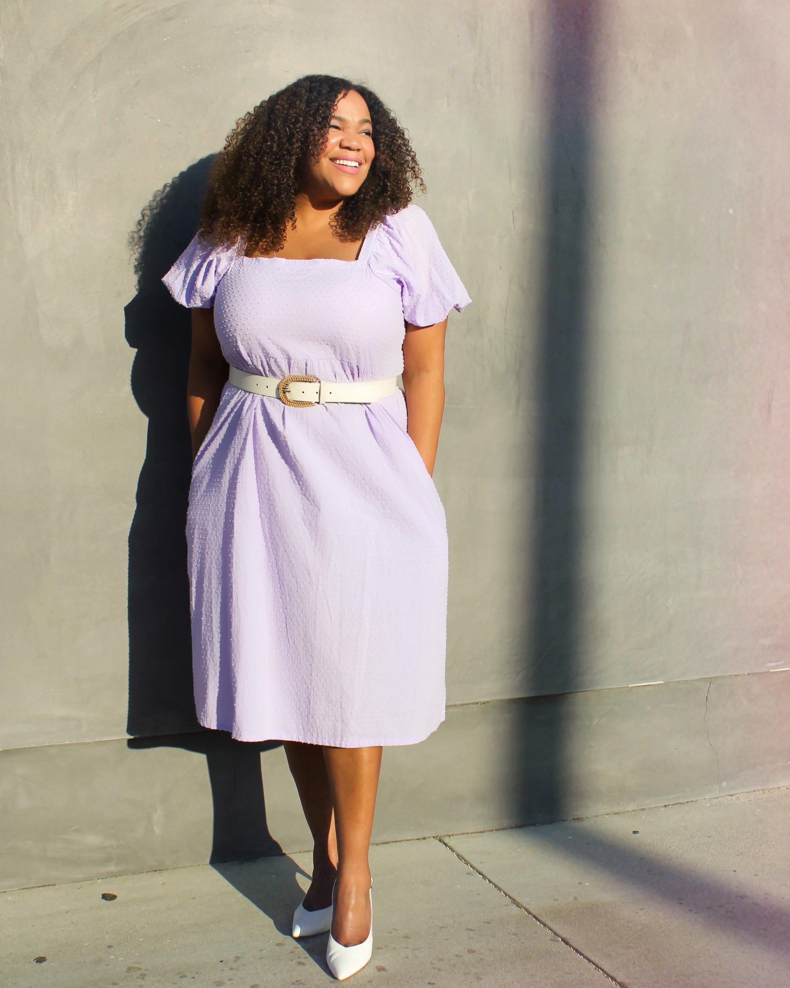 Black woman in purple dress