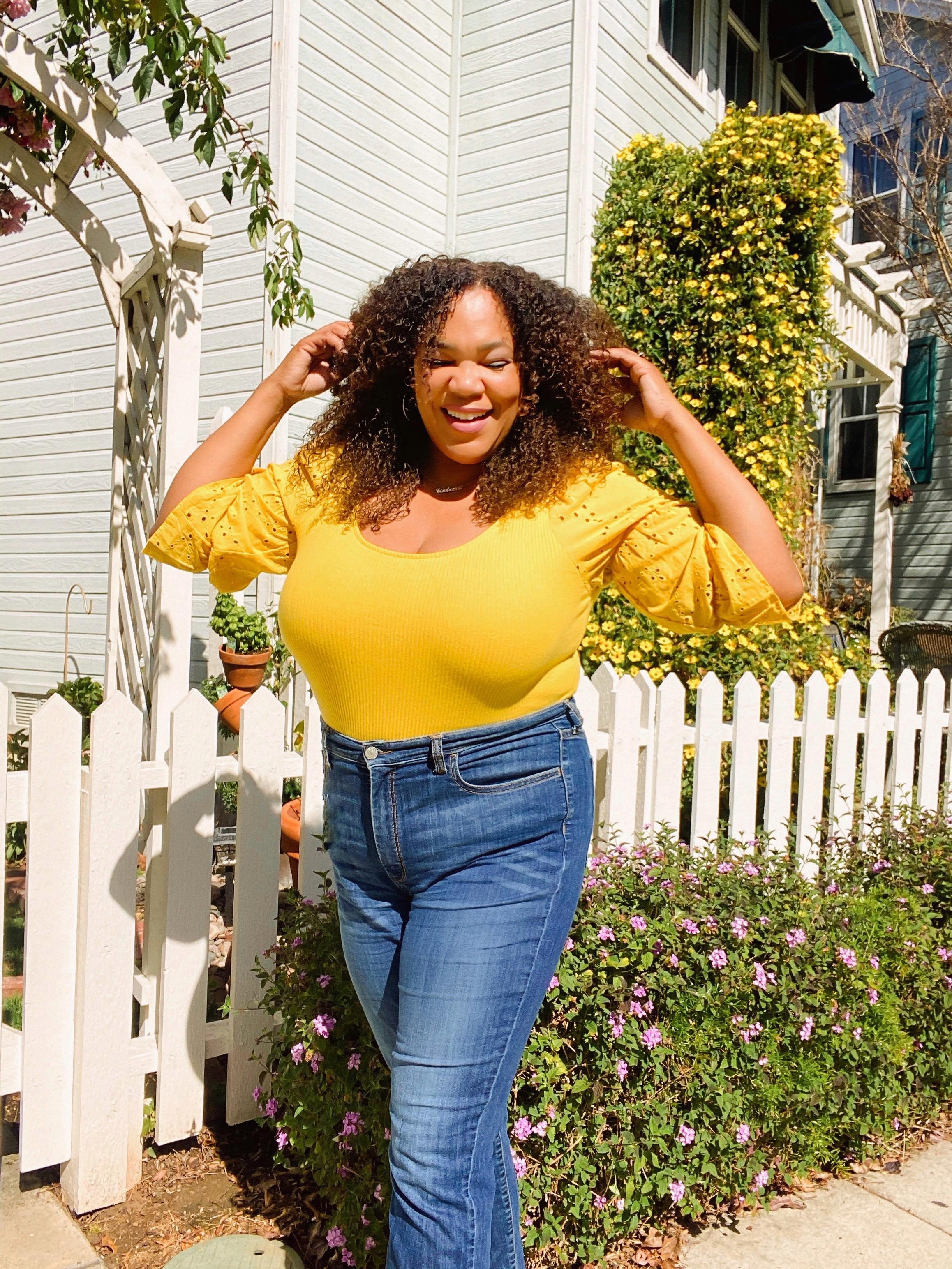 Black woman in yellow
