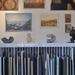 Framed wall prints and slotted frame storage.