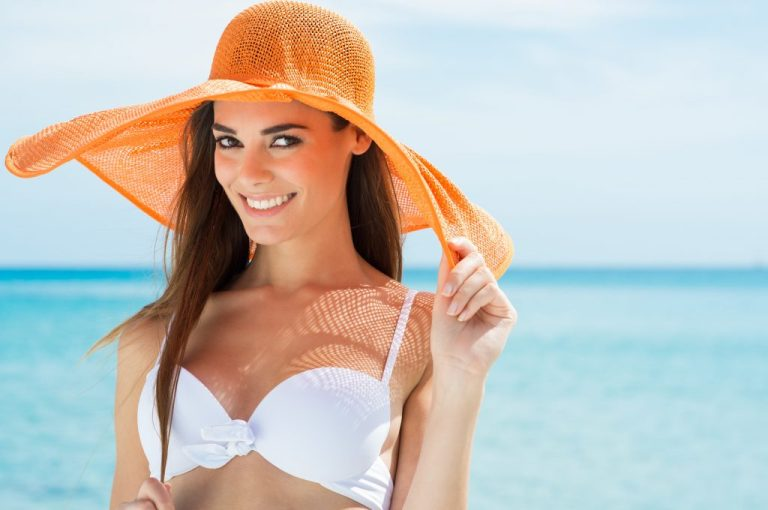 a smiling girl in bikini after waxing services in gainesville