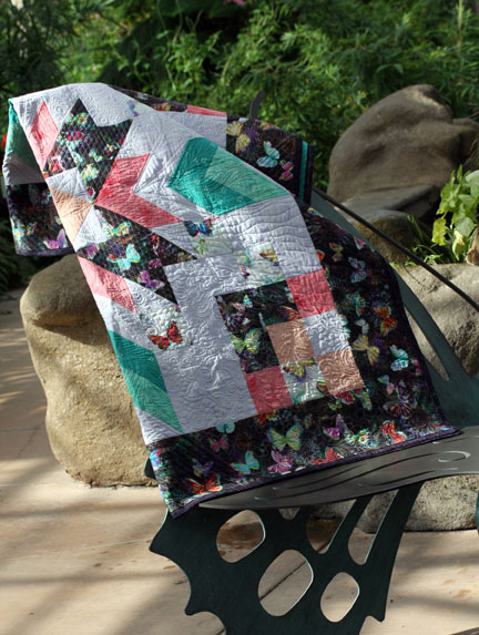 Half of quilt top showing on butterfly chair