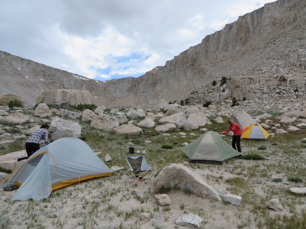 Setting up camp and hoping to dodge the weather