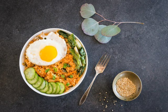 kimchi fried rice bowl with quick cucumber pickles
